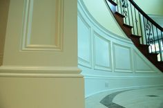 Interior entryway molding mimics classic architecture; wonder if I could eventually change railing to iron?