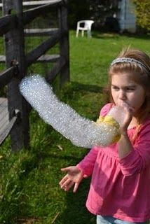 Bubble snake: water bottle, rubber band,Terry cloth (washcloth or sock) and dish soap with water..fun and easy!
