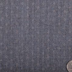 This is a fine wool suiting in chocolate brown with  coral pin stripes. Light weight, great for spring and summer suiting.