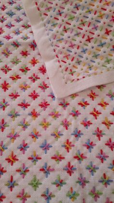 Sashiko, quilting - looks like this one used multicolour thread, e.g. Anchor Multi Coloured: http://www.hobbycraft.co.uk/anchor-multi-coloured-cotton-thread-colour-code-1375/560079-1104