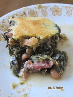 Greens & Cornbread Casserole  Ingredients:  1 large can margarette holmes seasoned greens  1 can of black eyed peas  chopped ham  chopped onion  1 to 2 boxes jiffy cornbread mix (if you like it thin or thick)    Mix seasoned greens, black eyed peas, ham, and onion together. Poor in to a 9X13 baking dish. Mix Jiffy cornbread according to packaged instructions. Pour on top and bake until cornbread is thoroughly cooked. Enjoy!! This is so awesome!!