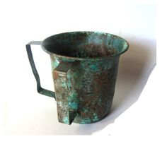 Old copper vessel. Old metal jug. Judaica ritual hand washing pitcher. Verdigris patina. Vintage.