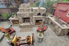 outdoor stone fireplace with pizza oven -