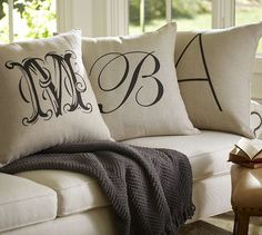 "Personalized Alphabet Pillow Cover | Pottery 1. Barn  1. ""D"" in Shelley font. 2. ""K"" in Masculine 3. 'H' in Helvetica"