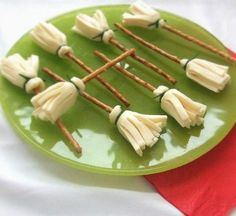 Pretzel, cheese witches brooms! Cut cheese, wrap around pretzel stick and tie off with chive 'string'! Could probably use cheese sticks for this as well.