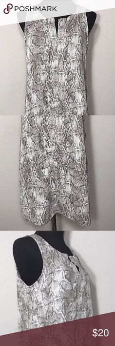 """Target Mossimo Tunic Snake Print Shirt Size M Mossimo Snake Print Tunic Blouse Shirt Brown White Size Medium. New without tags! 100% polyester. Sleeveless. Vented on sides at hem. Longer in length tunic top. Vented at center of neckline.  Bust 38"""" (97cm) Length 31.5"""" (80cm) Mossimo Supply Co. Tops Tunics"""