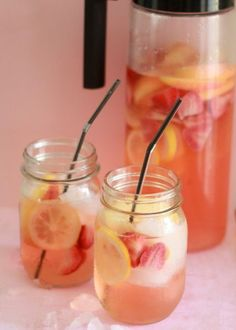White strawberry-lemon sangria ~T~ Lemons, Apple, Strawberries, 1 bottle white wine, 1/2 C. white rum and 4 C. lemon-lime soda.