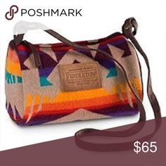 "⛰Pendleton Barrel Bag!⛰ ⛰Authentic Pendleton Barrel Bag!⛰ Classic, signature Southwestern/Aztec pattern shoulder bag in vibrant shades of tan, orange, yellow, blue, red, & purple! In Excellent Used Condition! Approximate dimensions are: 9.5"" L x 5"" W x 5.5"" D. Total strap length is 33"". Strap is detachable via side snaps, so a longer/shorter strap can be substituted to suit your needs! 82% wool, 18% cotton, lining is 100% polyester. No pockets. Top zipper closure. ❌No Trades❌ Reasonable…"