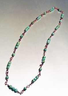 Turquoise and Copper Beaded, Wire Wrapped Necklace. $18.00, via Etsy.