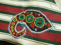 Drapes for Half-Tester.  Embroidered piece with shisha embroidery. Red and green paisley detail.