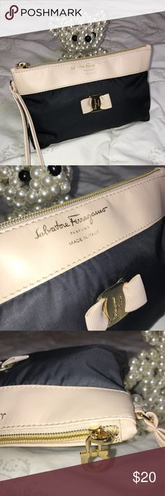 NWOT Salvatore Ferragamo cosmetic bag💄💅🏻💋 I've never used it. Selling this because I have many cosmetic bags. 😆 The colors actually are dark Navy and cream. Salvatore Ferragamo Bags Cosmetic Bags & Cases