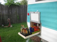 """Now THAT'S what I call good use of """"basement storage"""" in the RV! A pull-out bar:0"""
