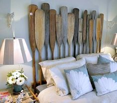 You could DIY that headboard with old paddles! Six Ideas for Coastal Bedrooms, Adore Your Place - Interior Design Blog