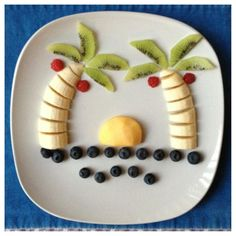 Cantaloupe sunset on Blueberry water | Paleo Kids Creative Meal Art Ideas | Thanks to Gabriela Fischer of Fun Meals 4 Kids for these terrific food sculptures featuring bananas and other nuritious & delicious foods! Gabriela is devoted to promoting nutrition education & healthy lifestyles, including coming up w/ amazingly fun ways to get kids to eat more fruits & veggies. For still more great photos displaying Gabriela's creative culinary genius, visit: Fun Meals 4 Kids on Facebook.