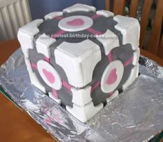 Homemade Companion Cube Cake from Portal Video Game: This Companion Cube Cake from Portal Video Game is a normal sponge cake with chocolate butter icing filling and fondant icing covering. It took 2 and a