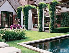 There is nothing hodgepodge about the way the garden color scheme is assembled from a limited palette of creams and greens in plant accents against the dramatic statement of the white-curtained pergola and patio areas. - Photo: Matthew Benson
