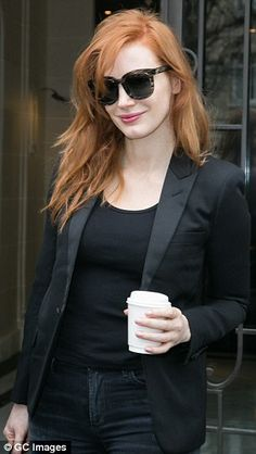 And pose: The flame-haired actress paired her black jeans with a classic blazer and huge s...