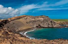 PAPAKOLEA BEACH  Where: Hawaii  Green sand and rocky cliffs make Papakolea Beach seem a bit like an alien landscape. Olivine crystals from the nearby volcanic cone give this beach its olive hue. Intrepid travelers should be prepared for a two-mile hike along rugged sea cliffs to reach this surreal beach on Mahana Bay. Be careful in the water—the surf is rough and full of strong currents.