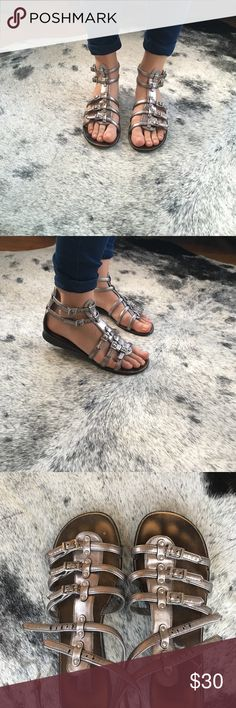 Steve Madden Gladiator Sandals Steve Madden Pewter Gladiator sandals in good condition. Finish worn off on interior part of sole, but bottom and straps still in good shape! Size 7.5 Steve Madden Shoes Sandals