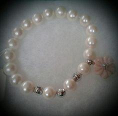 Pulsera de Perlas naturales, oro blanco 14kt, flor de nácar rosaso en oro blanco de 18 kts y diamantes. #bracelets #pearl