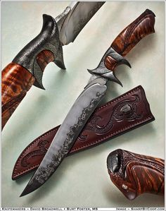 Broadwell's Integral Sub Hilt design. This custom order incorporates a blade from Burt Foster's laminated steel, damascus fittings, and a koa handle. This one has a higher level of carving than many of this model. Approximately $3100.
