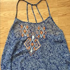 *FINAL SALE* Floral and Aztec print crop top Blue and white floral print tank top with Aztec design on the front. Multiple straps to make a design, very cute. Great condition, worn once. (4/17/15) Macy's Tops Crop Tops