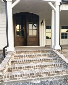 I like the brick steps and how they cover the front of the porch with brick.