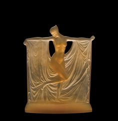 Press Center | Corning Museum of Glass. Suzanne Rene Lalique (French, 1860-1945) France, Combs-la-Ville or Wingen-sur-Moder, R. Lalique et Cie., 1925 Mold-pressed H: 23.1 cm, W: 18.3 cm, D: 5.4 cm Collection of The Corning Museum of Glass, Corning, New York, Gift of Elaine and Stanford Steppa (2011.3.256)