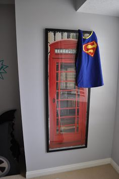 Amazing Superhero Boys Room!  I love how she ties in scripture to the room and her idea of using a hollow door as a canvas.  And I am in awe that she made her son a batmobile out of cardboard.  Wow!