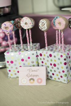 What great donut cake pops at a baby shower! See more party ideas at CatchMyParty.com. #cakepops #donuts