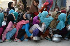 Jalalabad, Afghanistan  Children wait in line with their empty bowls to receive food donations in the city Photograph: Noorullah Shirzada/AFP/Getty Images, Jun 2016.