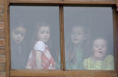 Four young children have a grandstand view of the St. Patrick's Day Parade
