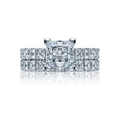style no. 32-3PR75. Asscher-cut diamonds are set along the shoulders of this Tacori engagement ring, featuring a Princess-cut diamond at the center.  A crescent shaped pattern frames the profile of the French cut style setting.