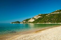 The beach of Agios Georgios Pagon - considered one of the most beautiful on the island, with characteristically cool waters and an endless sandy shore. https://greece.terrabook.com/corfu/page/agios-georgios-beach-pagon #Greece #Corfu #terrabook #GreekIslands #TravelTips #Travel #GreeceTravel #GreekPhotos #Traveling #Travelling #Holiday #Summer