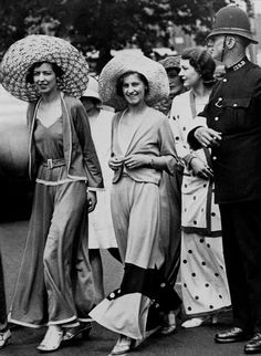 A policeman halts traffic for a group of women in the latest fashion, Beach Pajamas, circa 1933.