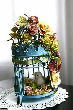 bird cage, artificial flowers and string lights for a night light
