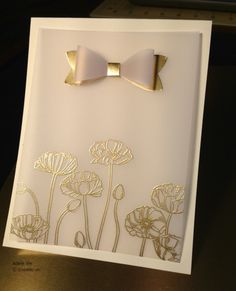 handmade card ... gold embossed poppies on vellum with a paper bow ...