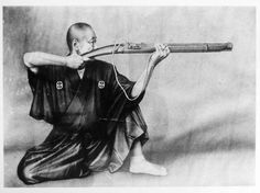 Samurai firing Japanese matchlock.