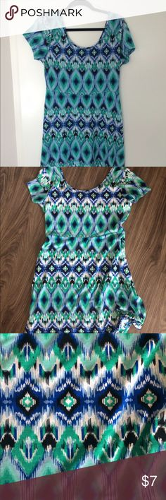 Size Large Summer Dress BNWT This is a light weight fashion dress with an empire waist line and a flared skirt at the bottom. Great peacock coloring, teal, green, blue and white!!  BNWT Dresses