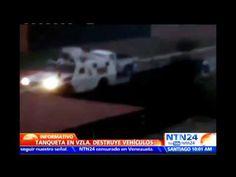 Tanqueta de la Guardia Nacional Bolivariana destruye varios vehículos pa...