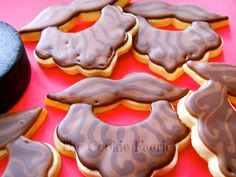 Lucky Playoff Beards!   Chocolate Glazed Rolled Sugar Cookie Hockey Team Treats by Robin Traversy {The Cookie Faerie}.