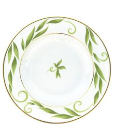 The lushness of flowers and vines, brought to your table. The Bernardaud Frivole rimmed soup dish (not shown) boasts a refined pattern and distinctive gold band. | Limoges porcelain | Dishwasher safe