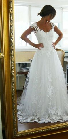 I love the laced top kind of look on a wedding dress. Makes it look so natural yet so beautiful. I do love this look ♡