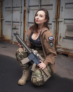 The image can contain: at least one person Military Women, Military Fashion, Tactical Clothing, Military Guns, Warrior Girl, Female Soldier, N Girls, Sexy Hot Girls, Bucky