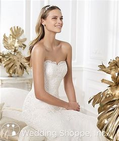 Pronovias Bridal Lanete  gown include: •Tulle fabric •Guipure lace throughout •Strapless neckline with lace edging •Mermaid style skirt •Comes with Guipure lace jacket and 3/4 length sleeves •Available with or without crystal beading •Chapel length train