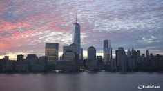 The cloudy and colorful sky looked awesome as the sun rose over NYC this morning, September 8, 2014. One World Trade Center and the other beautiful skyscrapers as seen from the EarthCam webcam at the Hyatt Regency in Jersey City.
