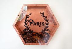 How to make these gorgeous wall mounted coin vaults. Wooden and spray painted in metallic paint, you can put copper coins in the copper piece, silver in the silver, and so on! Plus the front designs are EASY to make and can be whatever design you wish. The materials for the project are inexpensive and the tutorial even shows you how to make these out of pallet wood! #pallet