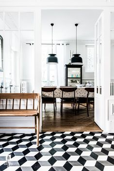 black and white patterned tiles to make an impact in the hallway