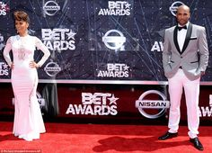 Gorgeous couple: Nicole posed at a distance from her husband, Boris Kodjoe, who looked hun...