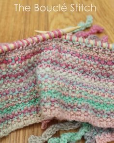 The Knitted Bouclé Stitch.  Based on the linen stitch, it is perfect for knitting scarves in self striping yarn.